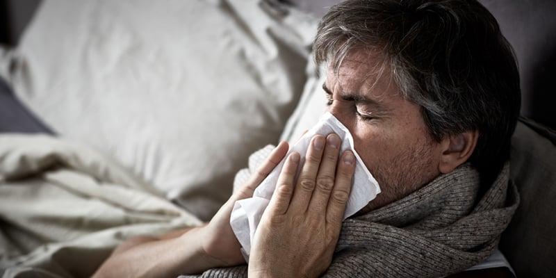 safety-flu-sick-man-home-sneeze