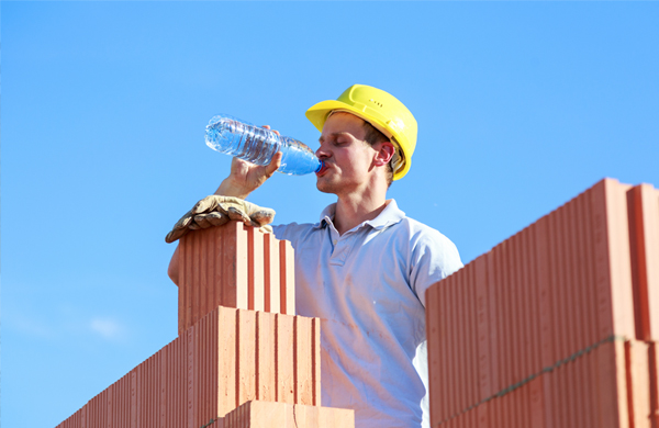safety-worker-drinking-construction-heat
